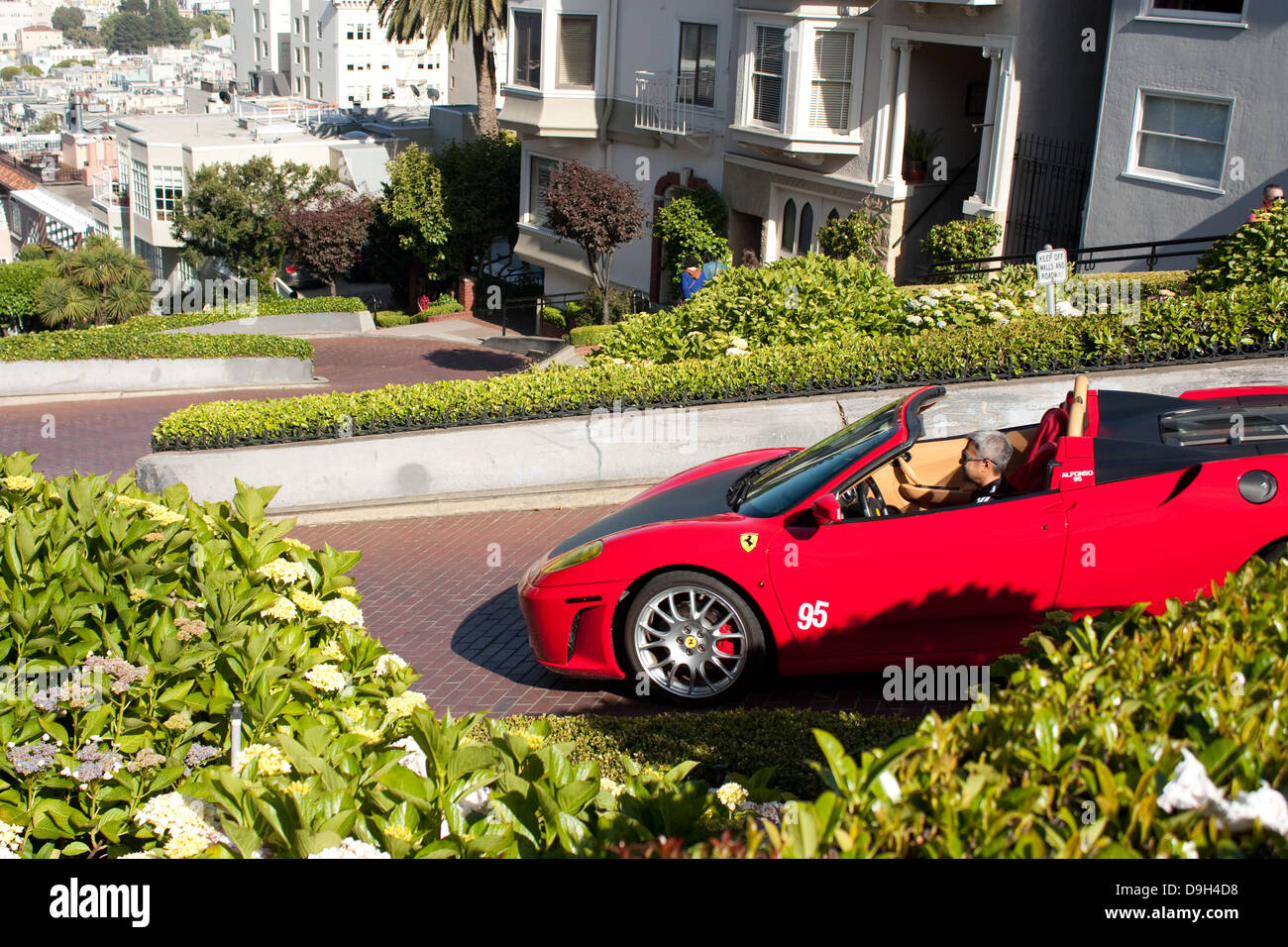 ferrari 430 negotiating lombard street curves, san francisco stock
