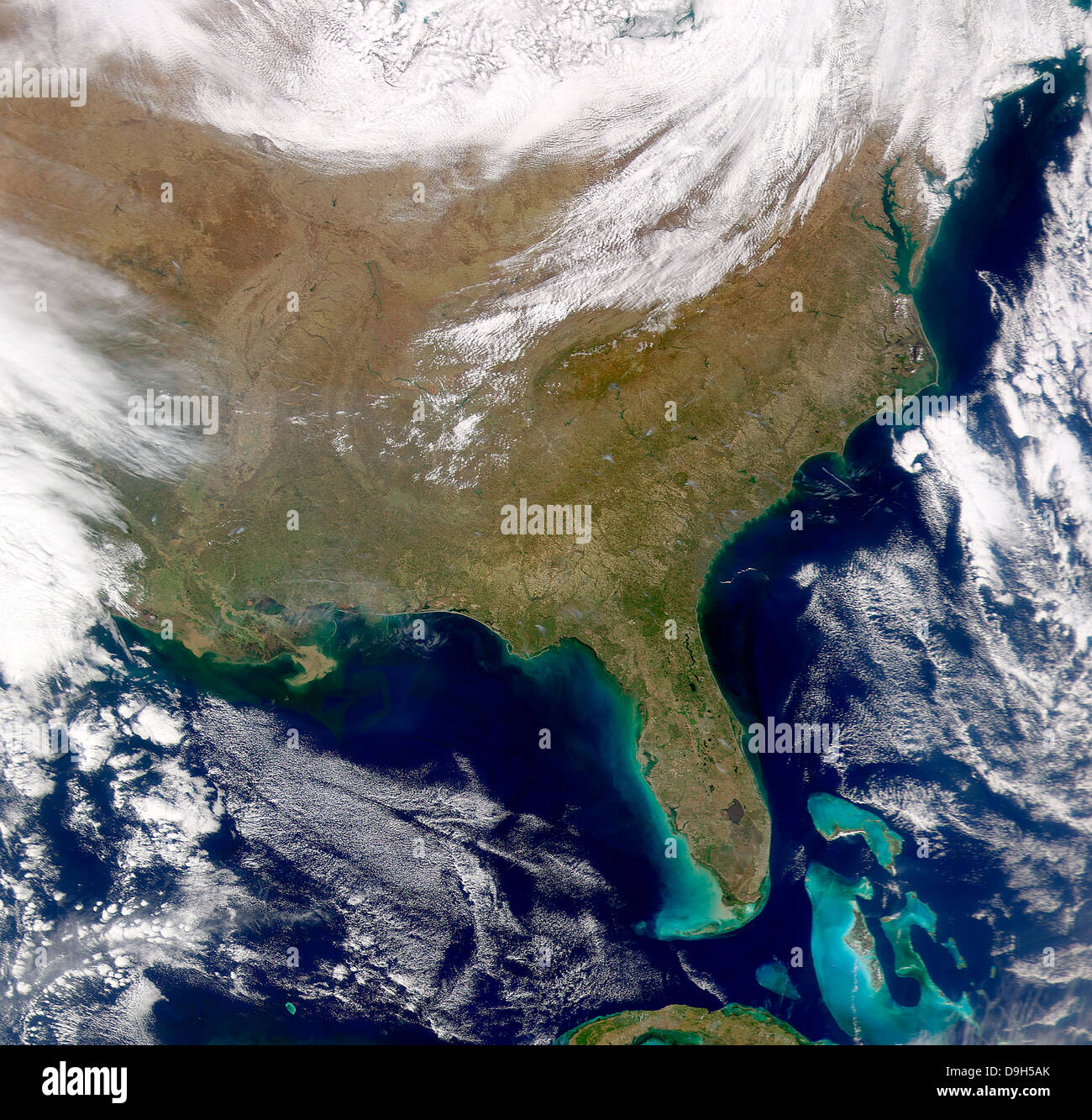 Satellite view of the southeastern United States. Smoke plumes are visible amongst the cloud-free skies. - Stock Image