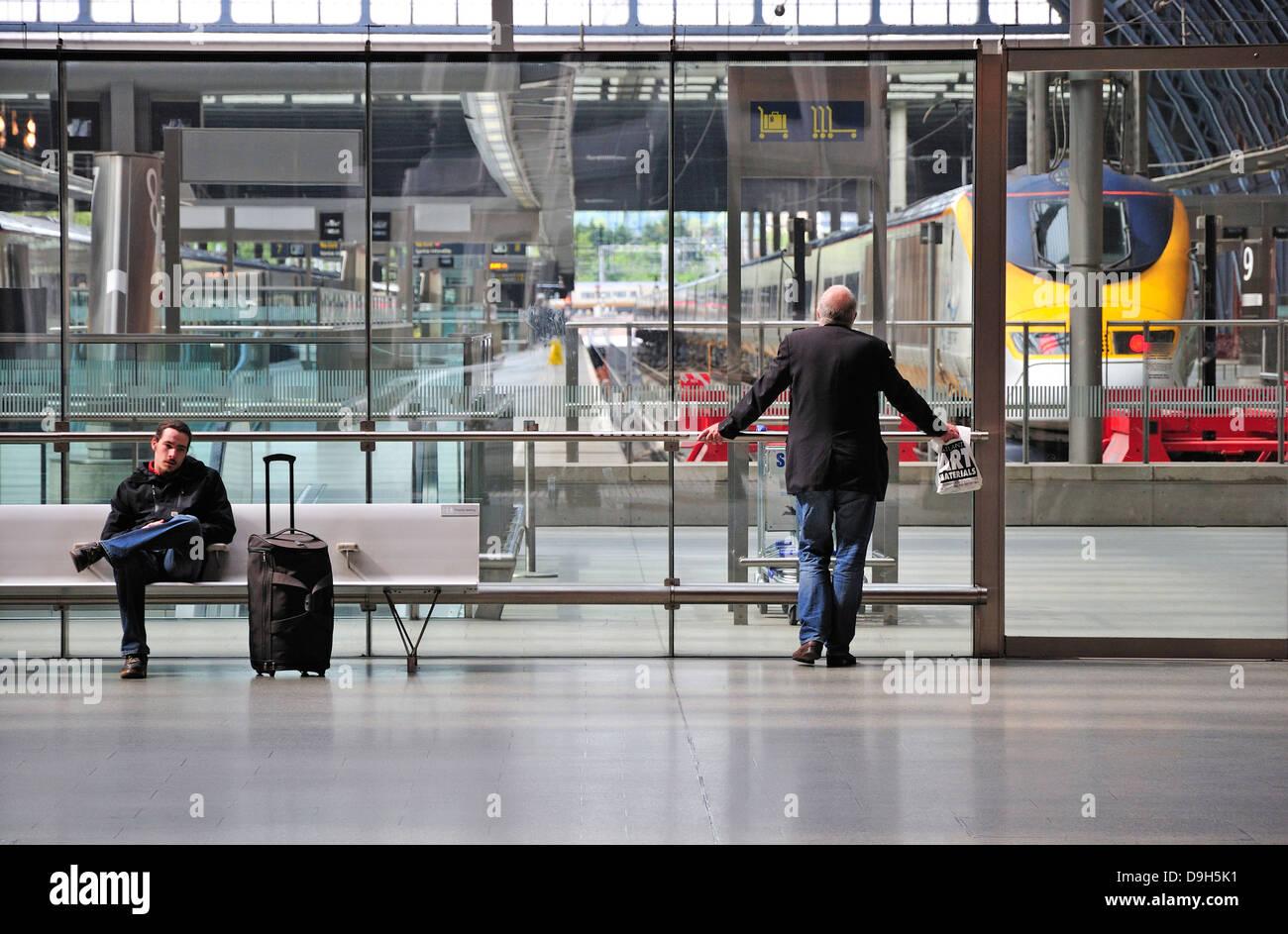 London, England, UK. St Pancras International Railway Station. Two men waiting by Eurostar terminal - Stock Image