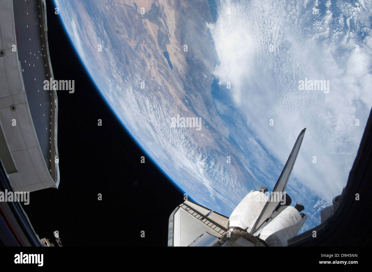 Part of space shuttle Discovery backdropped against the Pacific Coast of California. - Stock Image