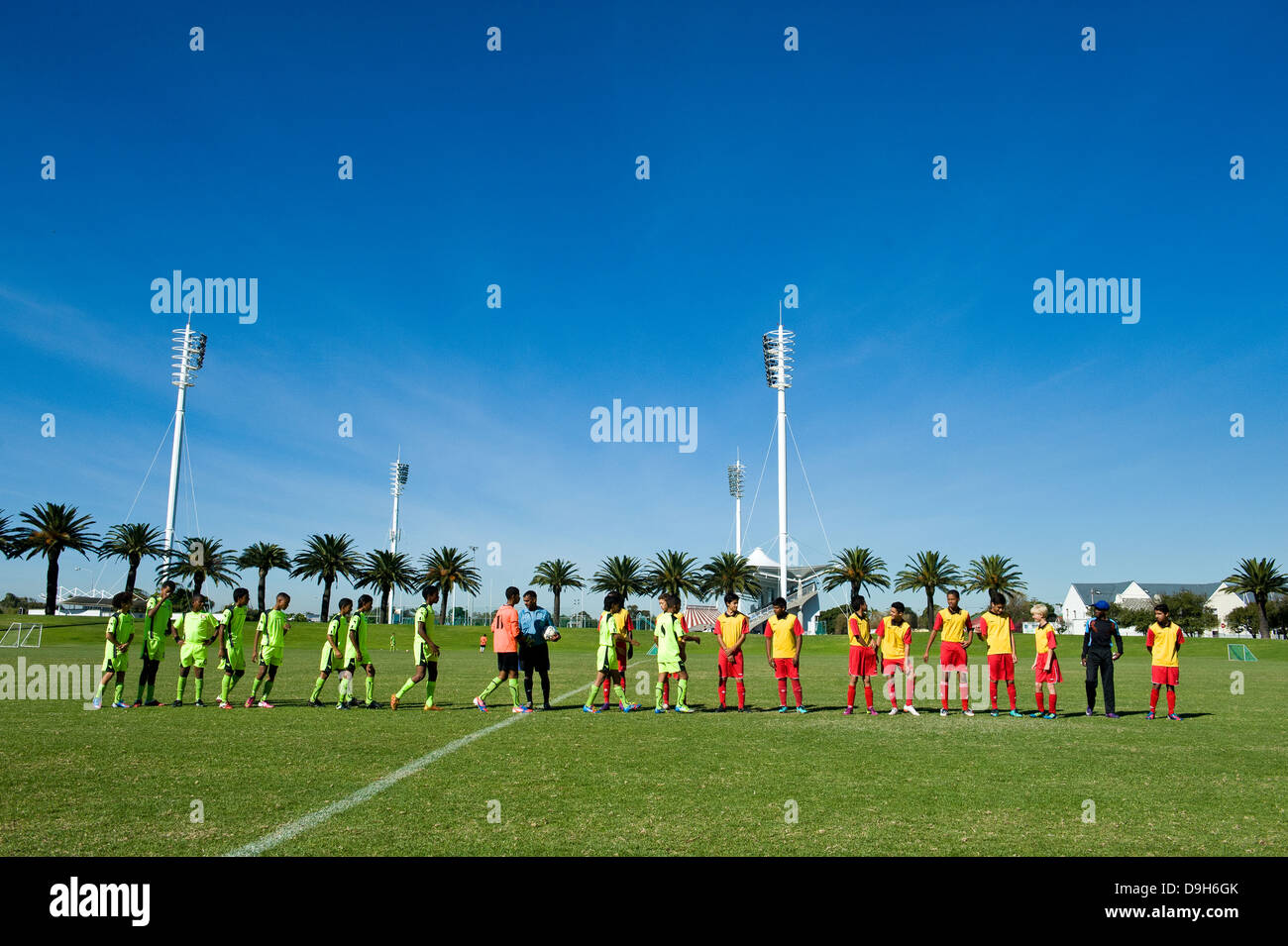 Youth U 15 football teams greeting another before playing a match, Cape Town, South Africa - Stock Image