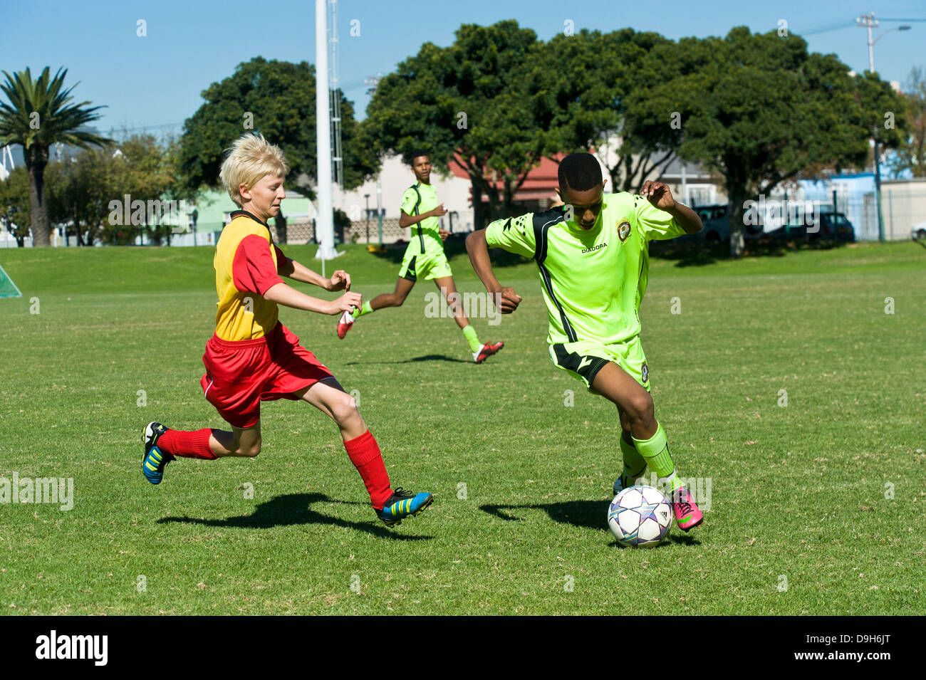U15 Junior football teams playing a league match, Cape Town, South Africa - Stock Image