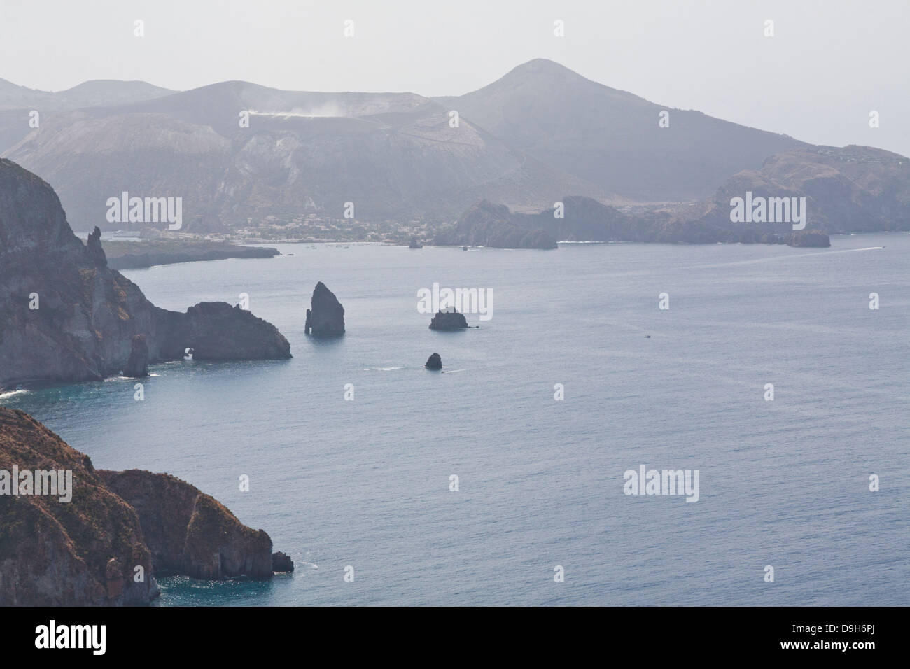 Quattrocchi viewpoint over Vulcano and the spiky faraglioni rocks, Lipari, Aeolian Islands, Italy - Stock Image