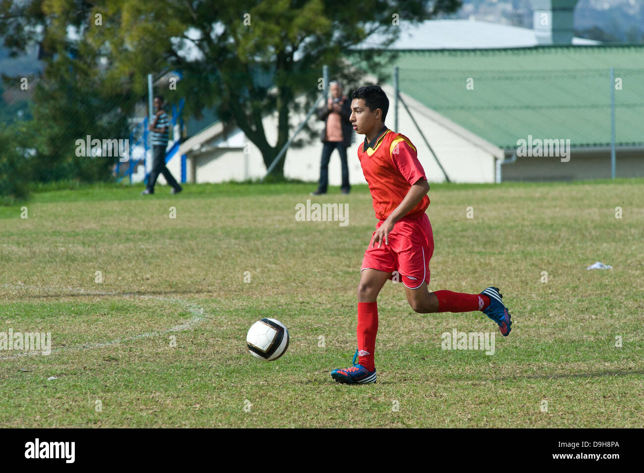 U15 Junior football player in a league match, Cape Town, South Africa - Stock Image
