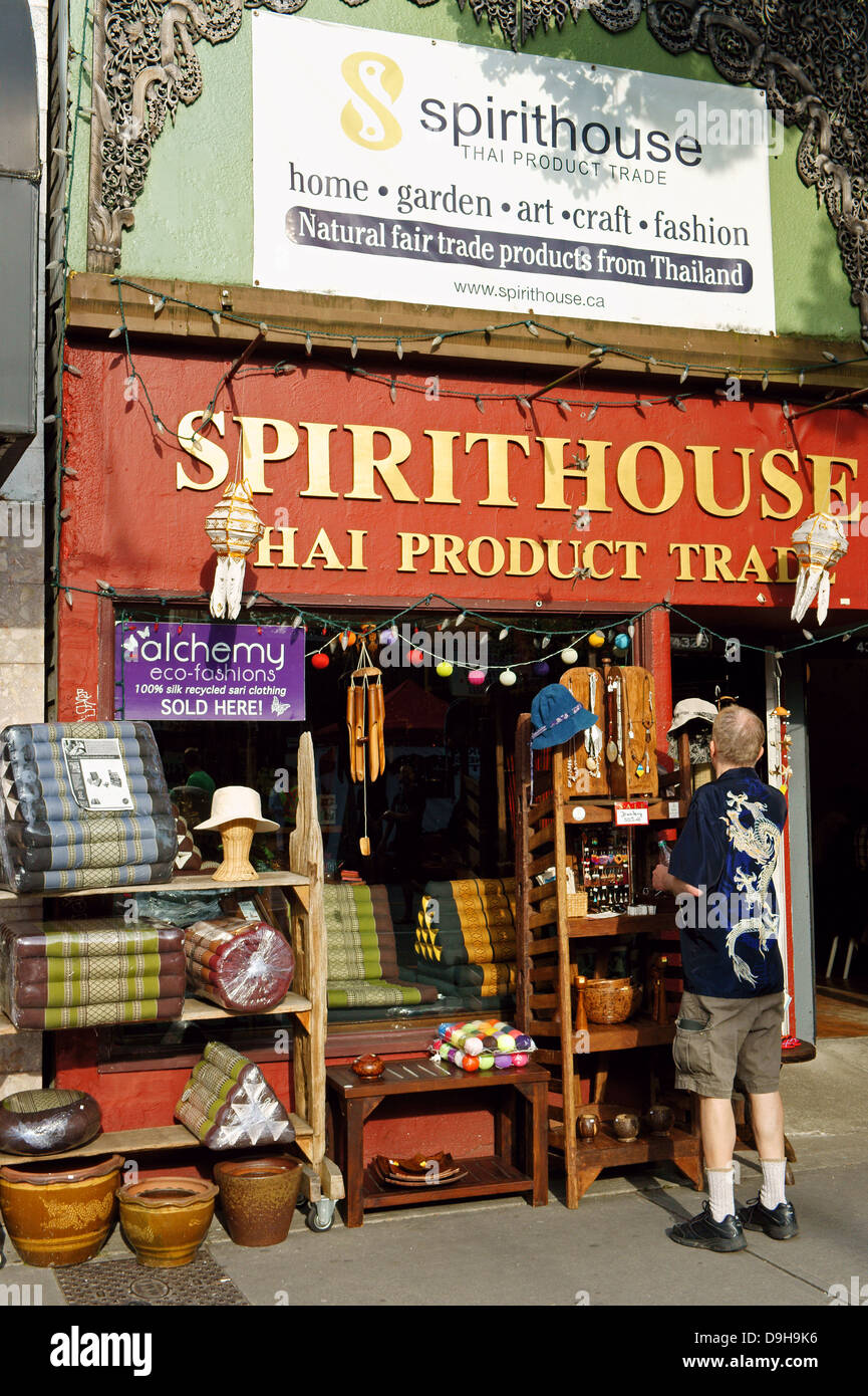 Man browsing at handicrafts outside Spirithouse Thai fair trade products and handicrafts store on Main Street, Vancouver, - Stock Image
