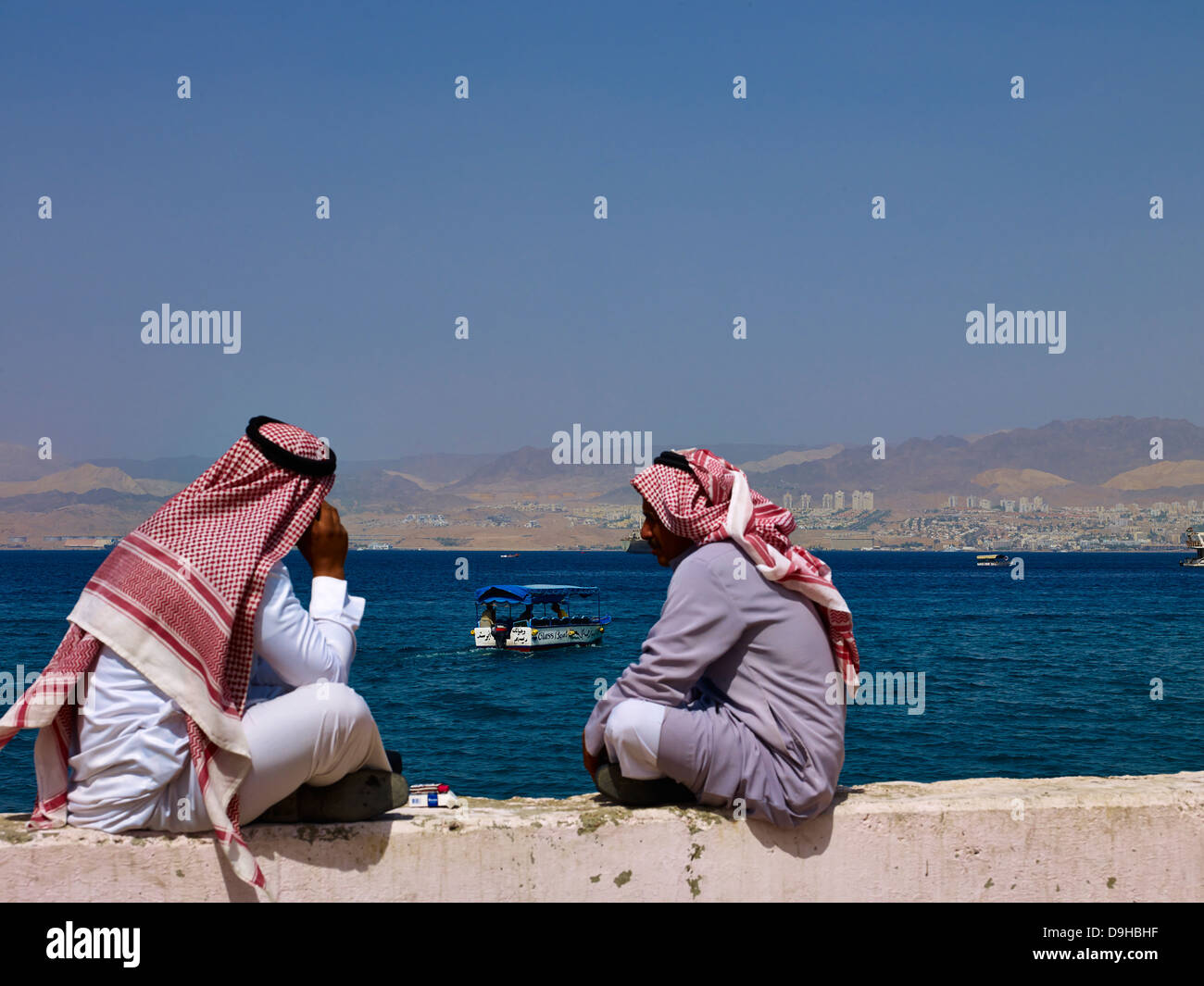 Two Bedouins in the Gulf of Aqaba, Jordan, Middle East - Stock Image