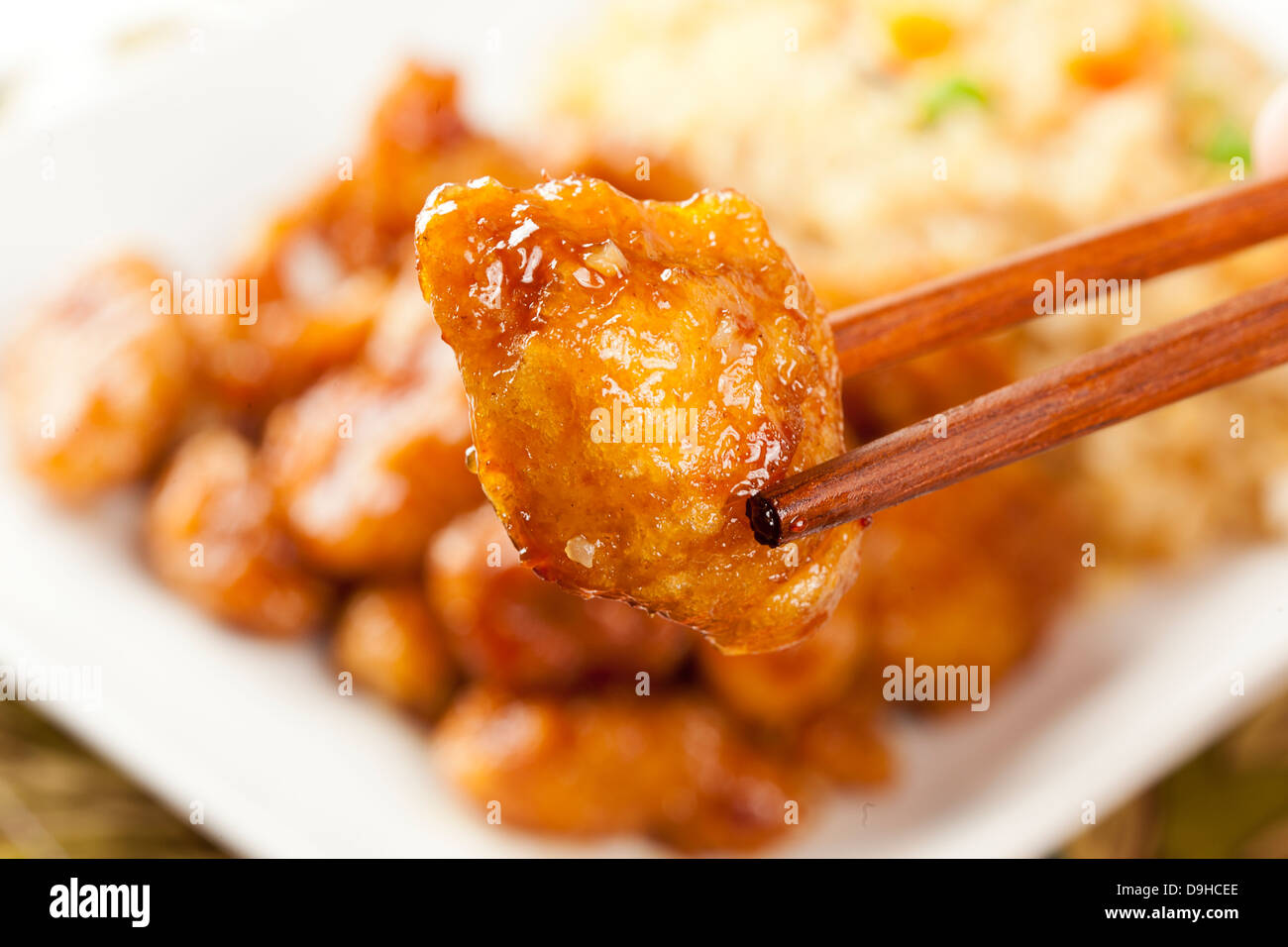 Homemade Orange Chicken with Rice on a background - Stock Image