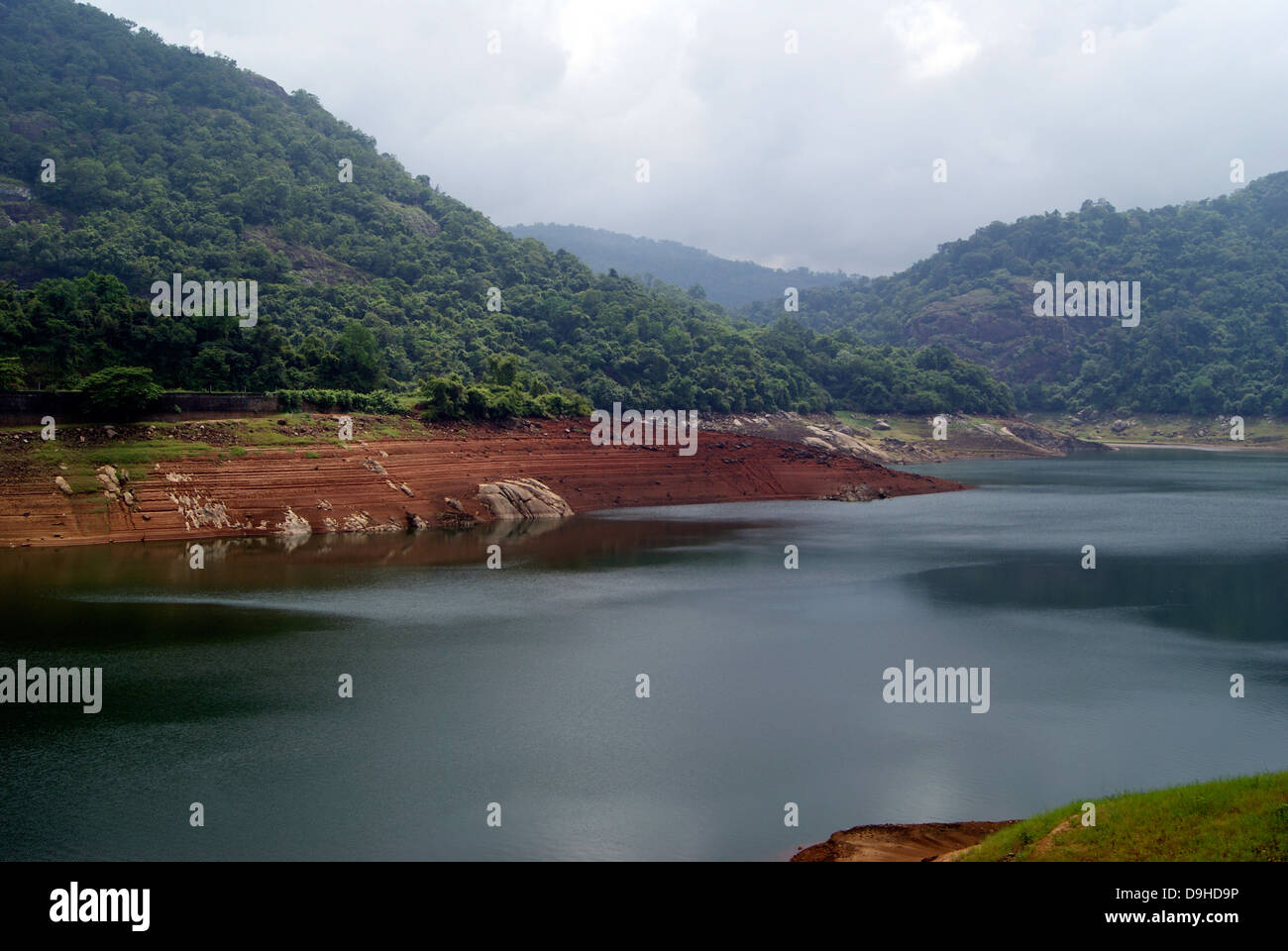 Thenmala Dam Reservoir and nearby Forest area Landscape in Kerala India - Stock Image