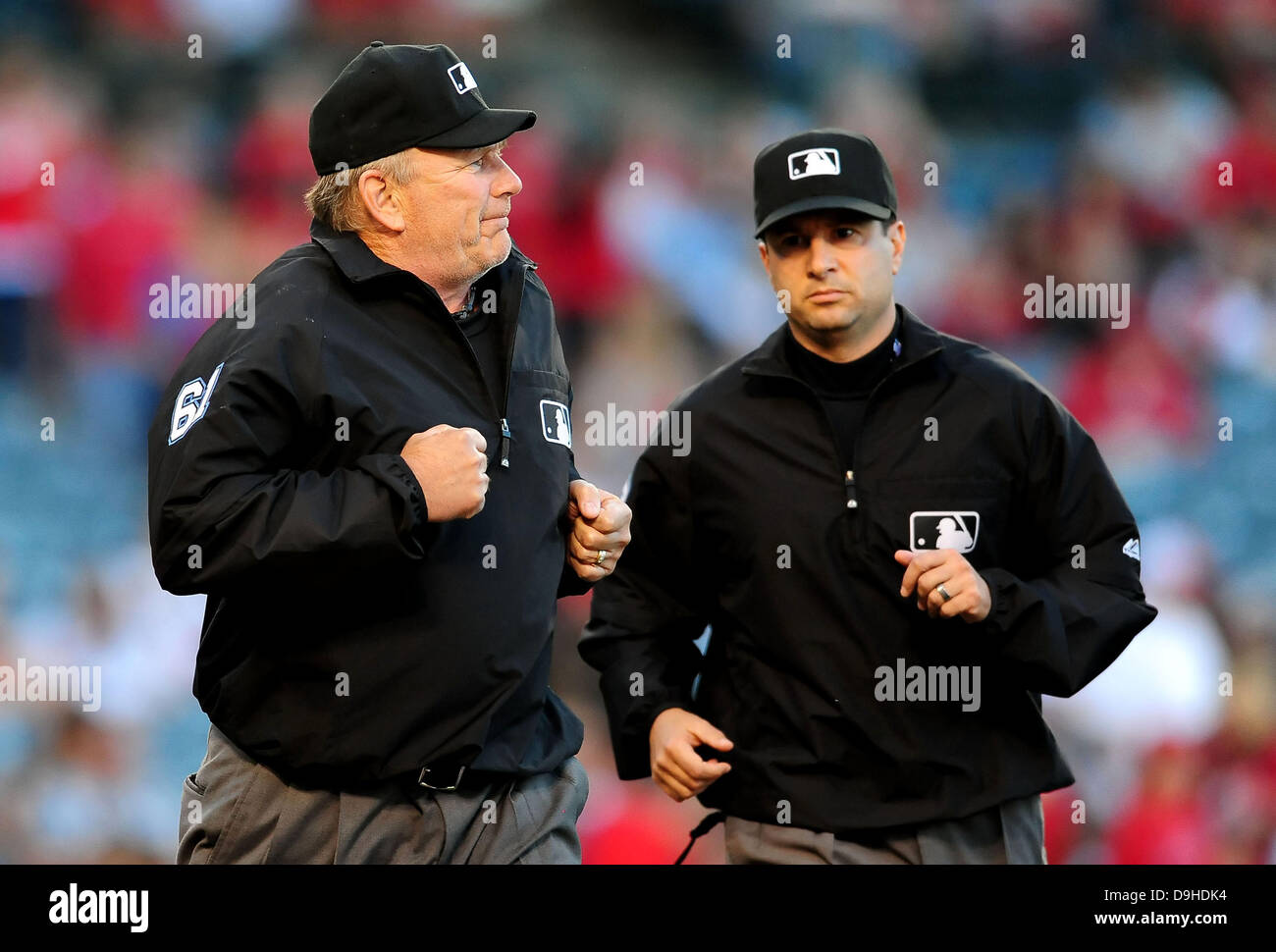 Umpire Bob Davidson (61) and umpire Jim Reynolds (77) during the Major  League Baseball game between the Seattle Mariners and the Los Angeles  Angels at ... afeb018754f