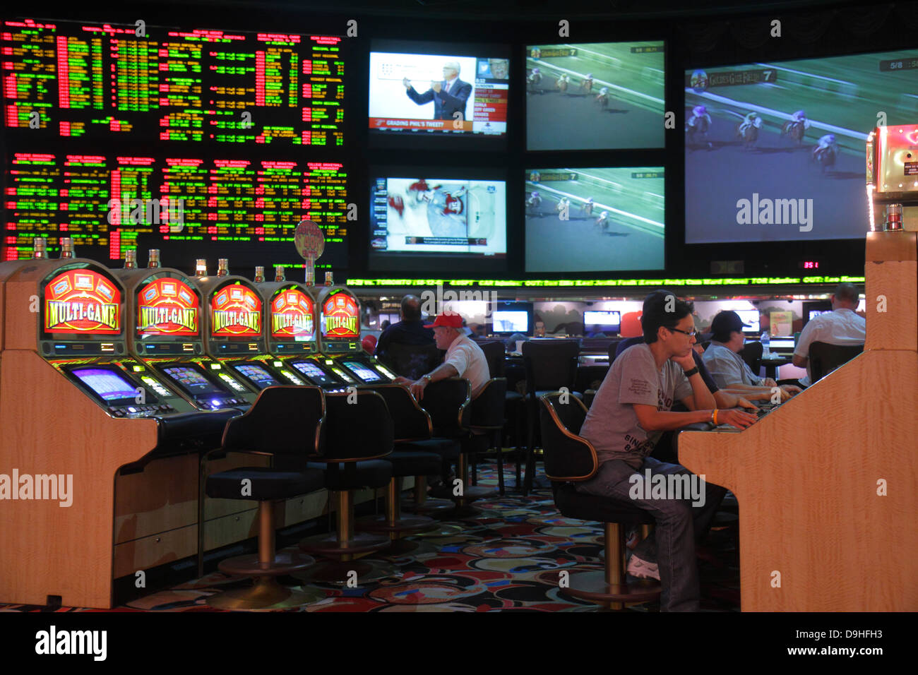 Nevada Las Vegas Las Vegas Hotel & Casino LVH race sports book betting odds gamblers gambling monitors big screens - Stock Image