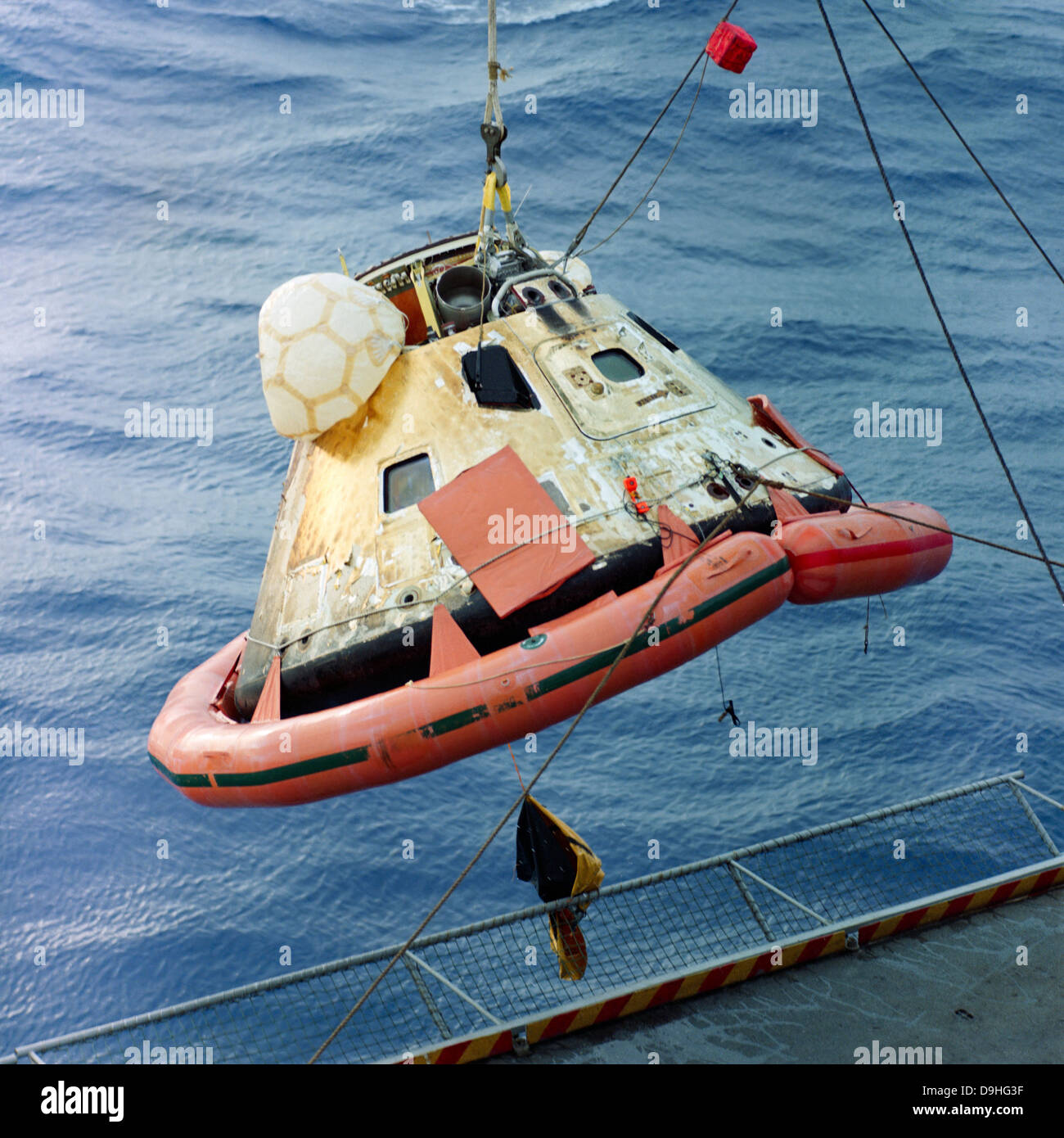 The Apollo 8 capsule being hoisted aboard the recovery carrier. - Stock Image