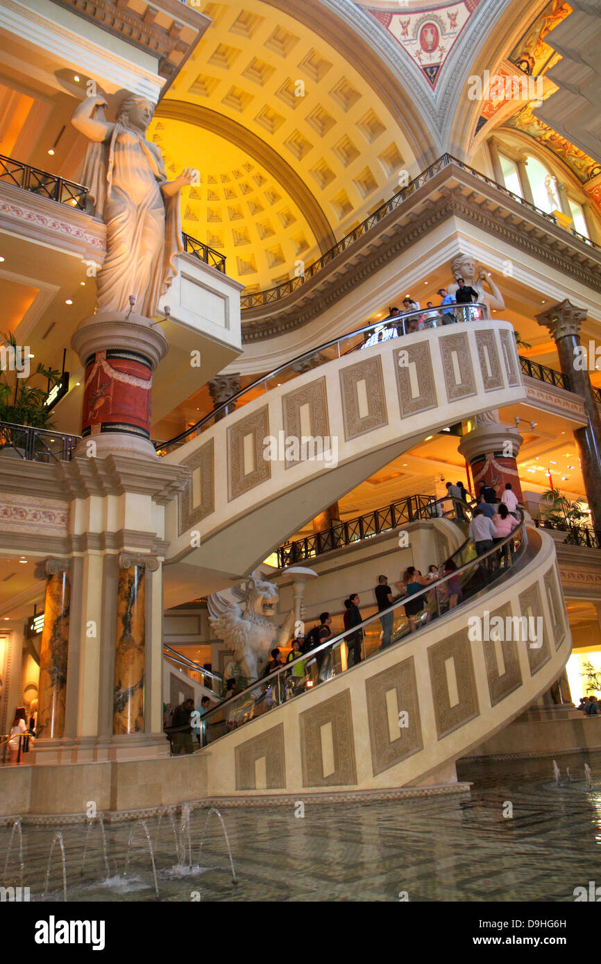 Nevada Las Vegas The Strip South Las Vegas Boulevard Forum Shops at Caesars Palace shopping escalator shoppers statue - Stock Image