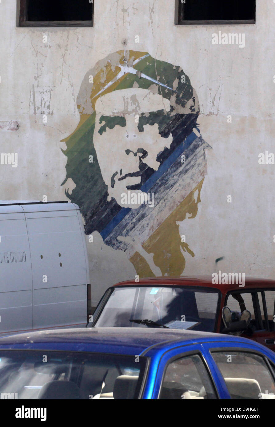 A graffito of the revered revolutionary leader Che Guevara is on display on a derilict wall in the city centre of - Stock Image