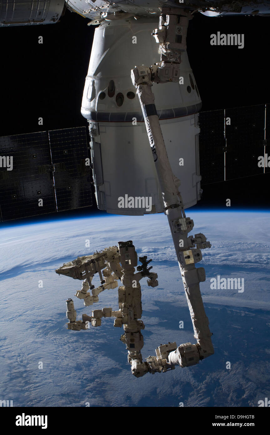 The SpaceX Dragon commercial cargo craft berthed to the ISS. - Stock Image