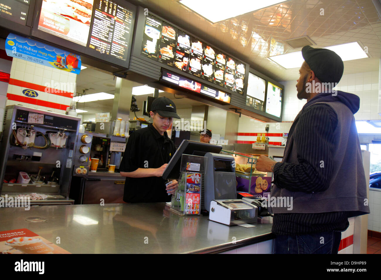 Nevada Las Vegas Sahara Avenue McDonald's fast food restaurant employee job behind counter taking order teen - Stock Image