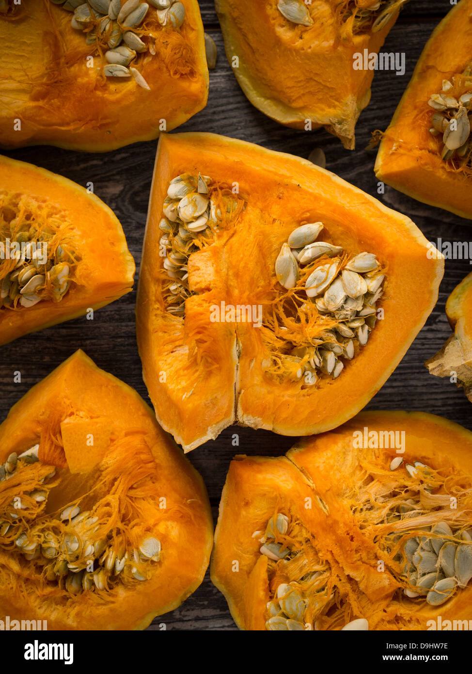 Raw pumpkin on a wooden table. - Stock Image