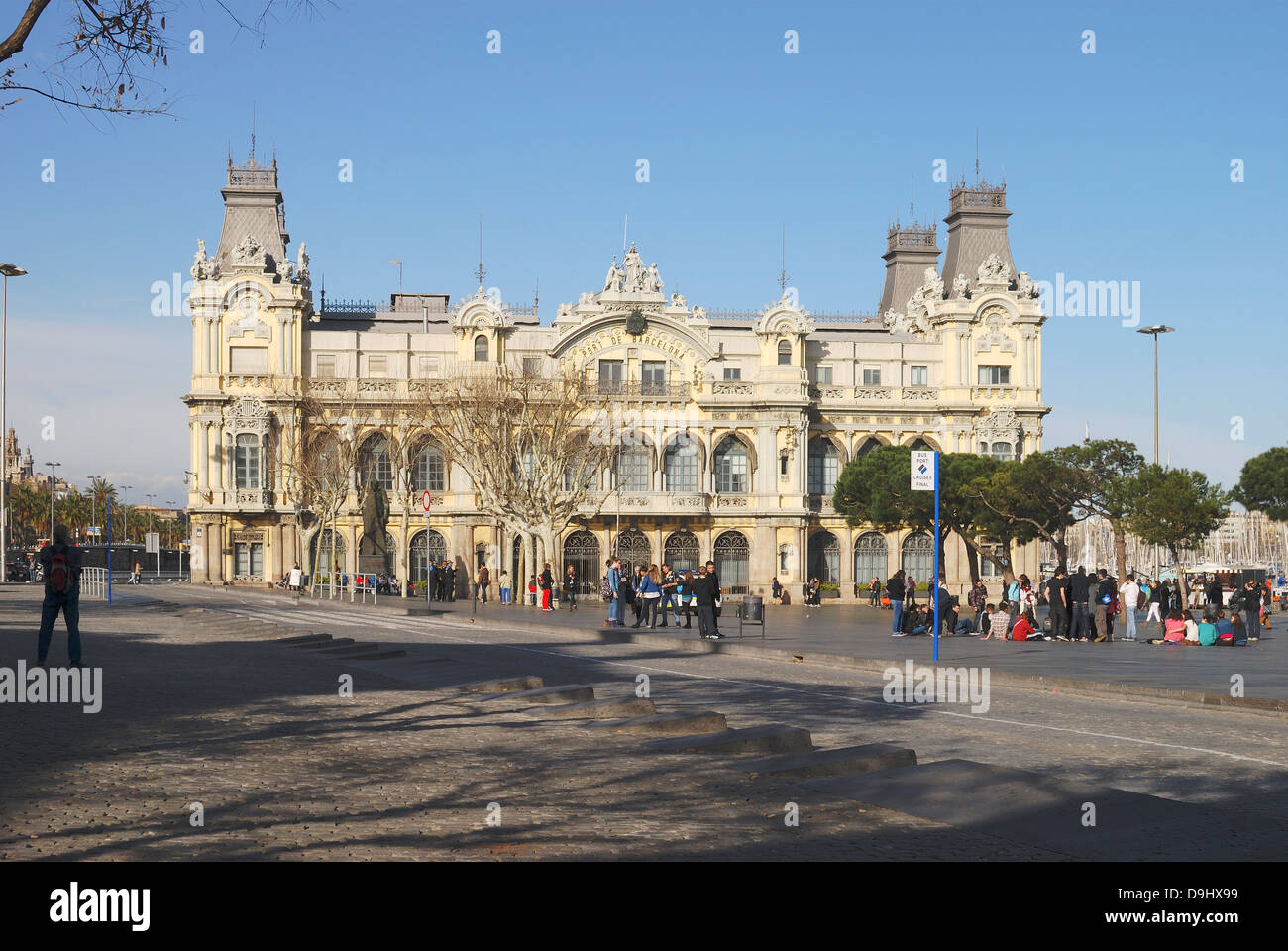 Traditional old Port Authority building by harbour at Barcelona. Catalonia. Spain. With people in square. - Stock Image