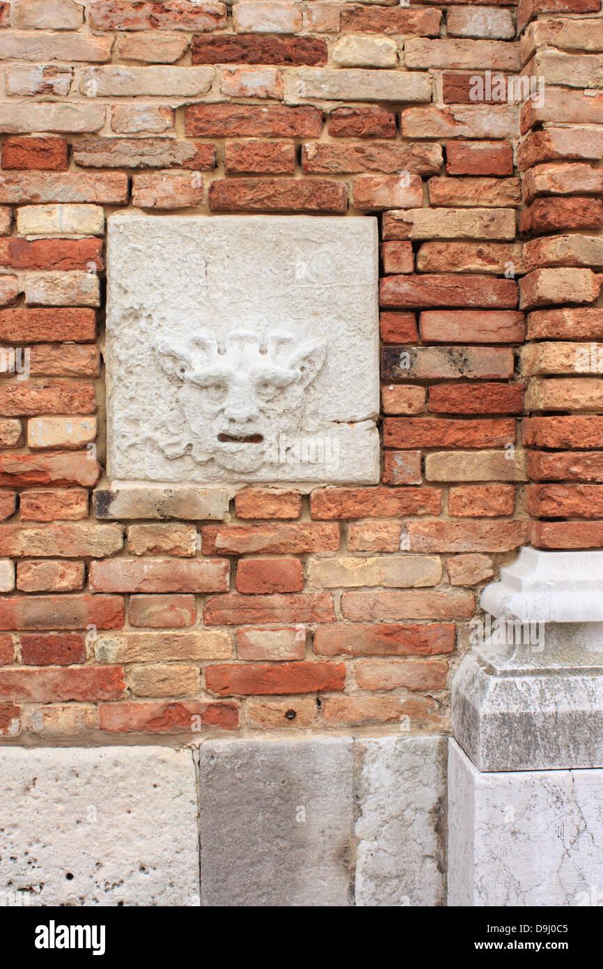 Bocca di leone (Lion's Mouth) postbox, 15th century denunciation box at church Chiesa di San Martino Stock Photo