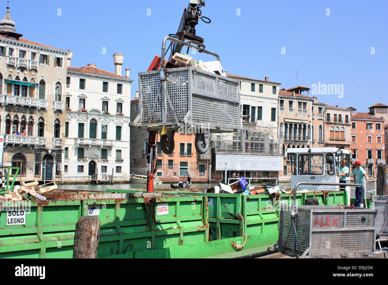 Waste services in Venice, refuse collection by boat after the Rialto fruit market. - Stock Image