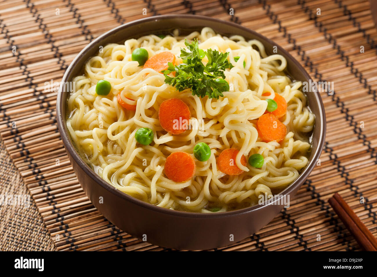 Homemade Quick Ramen Noodles with carrots and peas - Stock Image