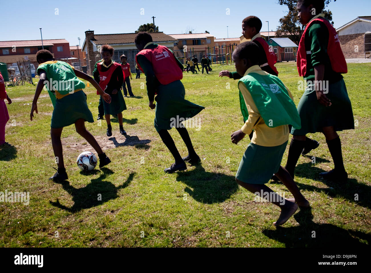 Grassroot Soccer uses power soccer to educate inspire mobilize communities to stop spread HIV Girls playing football - Stock Image
