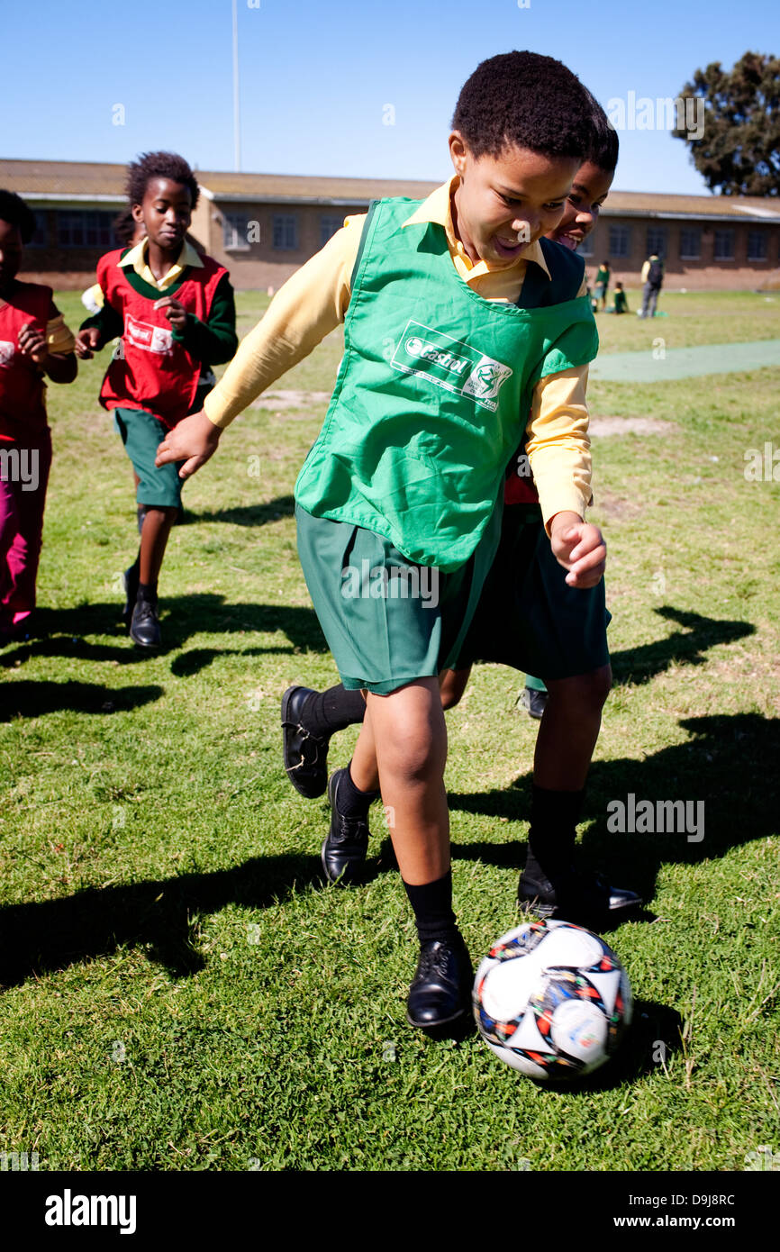 Grassroot Soccer uses power soccer to educate inspire mobilize communities to stop spread HIV Likhona plays in football - Stock Image