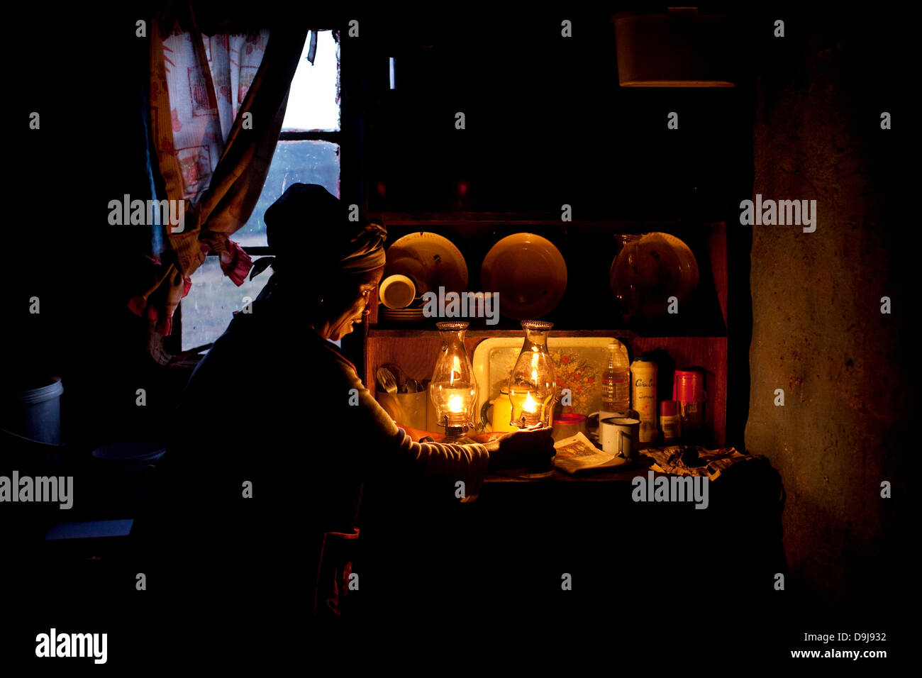 africa; african; african lady; africans; candlelight; culture; eastern cape; fashion; kitchen; lady; lighting paraffin - Stock Image