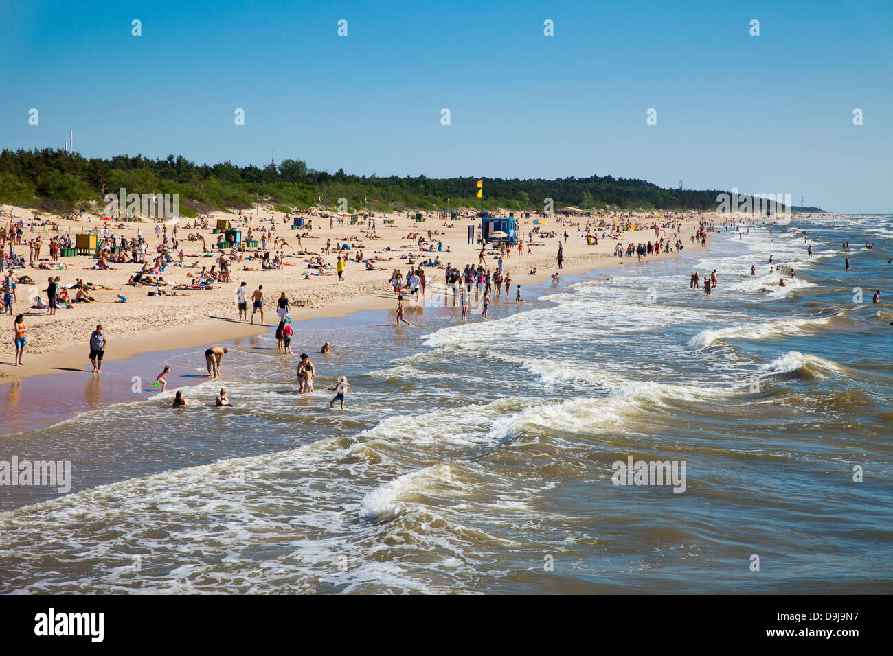 Palanga beach at summer full on people having fun. Palanga is a popular resort in Lithuania. - Stock Image