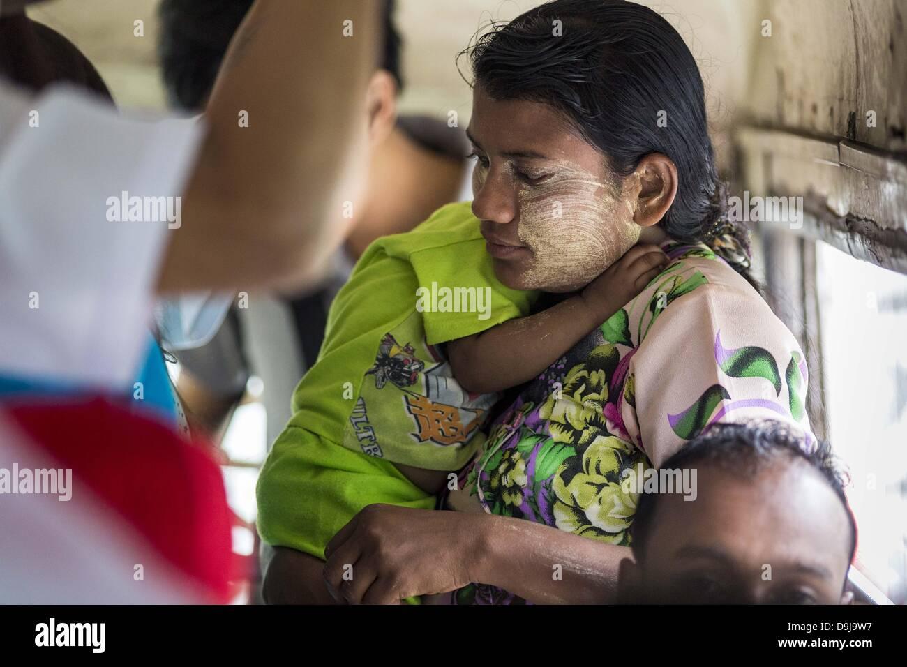 June 19, 2013 - Yangon, Union of Myanmar - A woman with