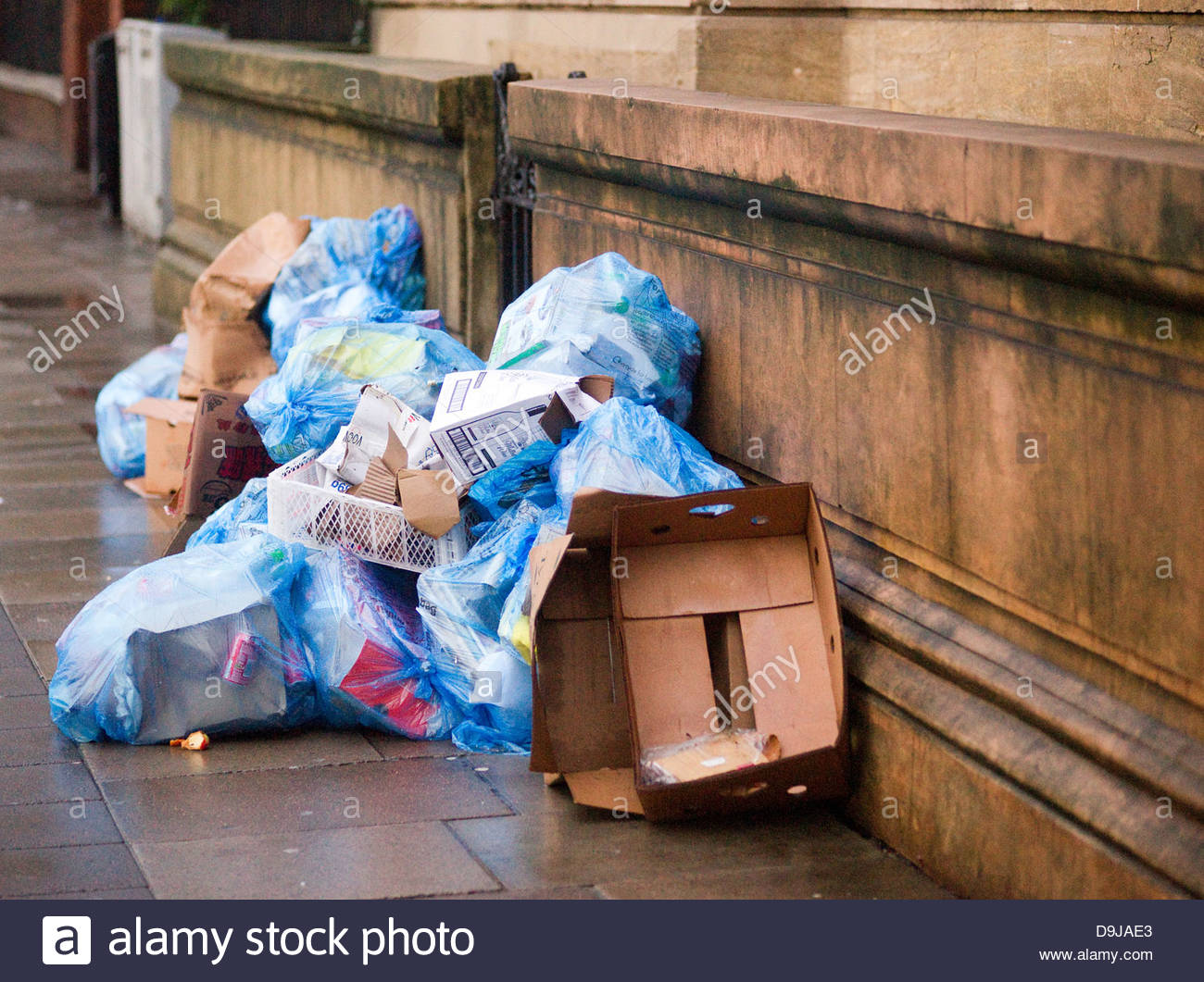 bag city cleanup close collection consumer dirty dustbin environmental garbage outdoor pollution refuse rubbish - Stock Image