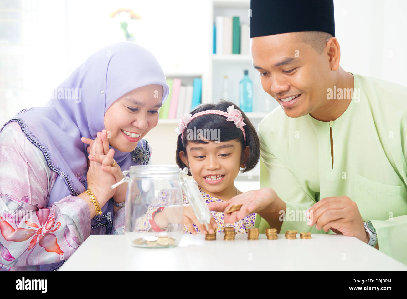 Islamic banking concept  Southeast Asian family counting