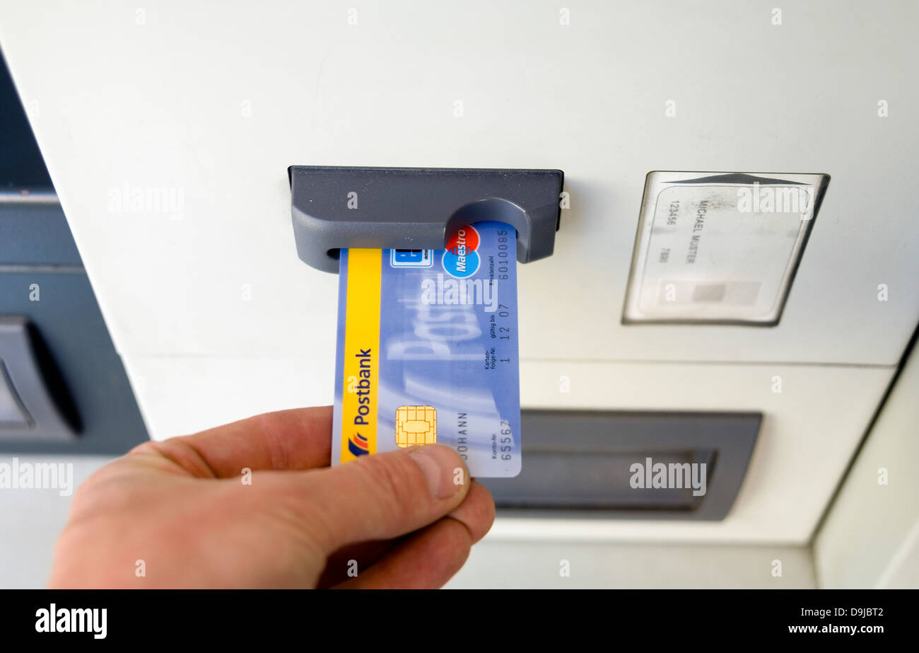Hand with EC-Card on Bancomat from German Postbank - Stock Image
