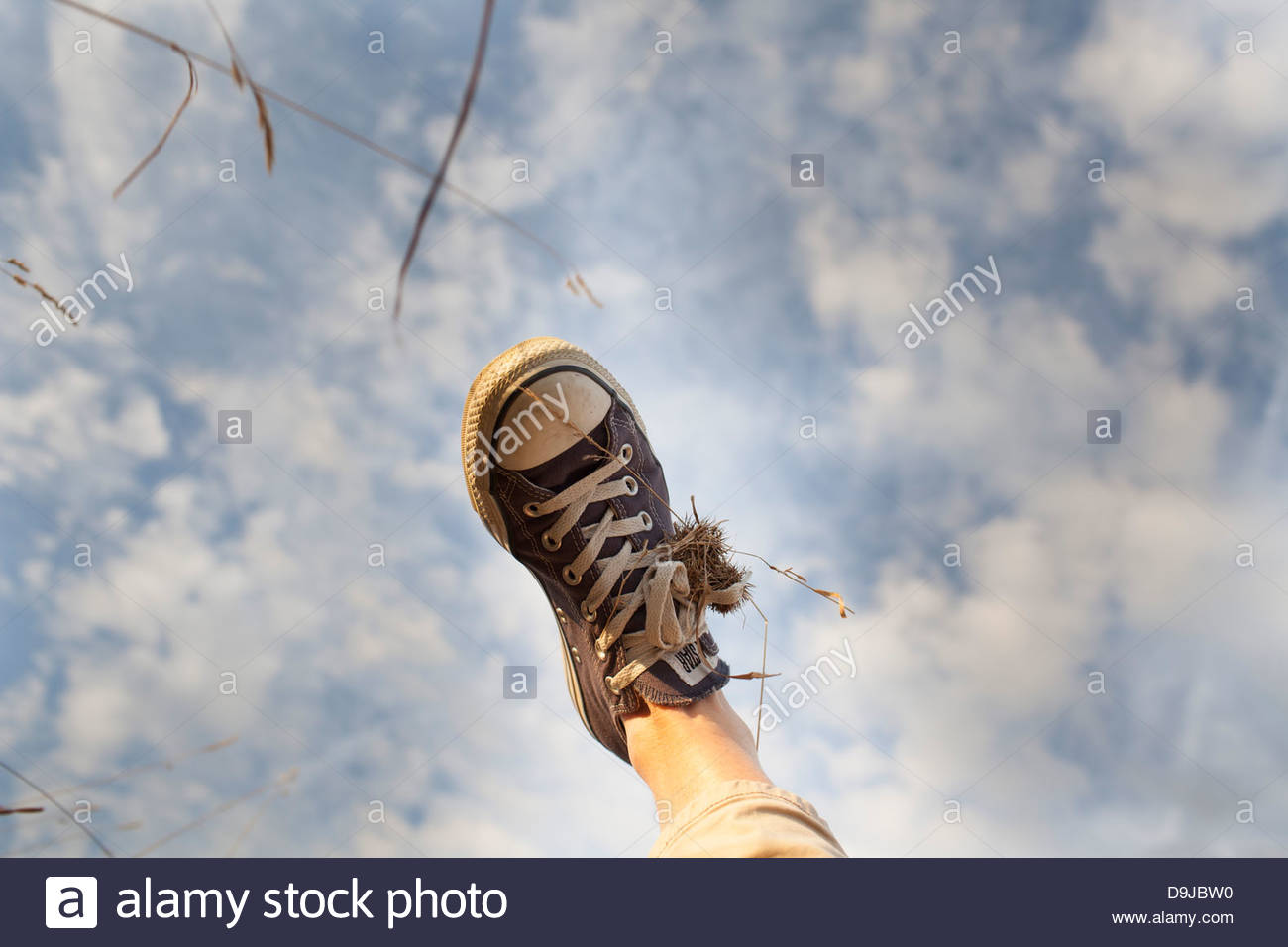 Human foot in the air - Stock Image