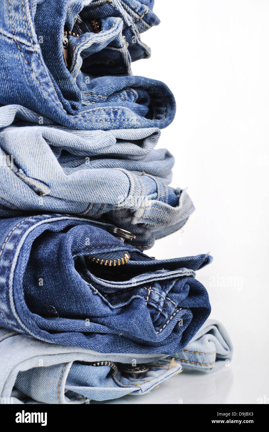 Stack of folded jeans - Stock Image