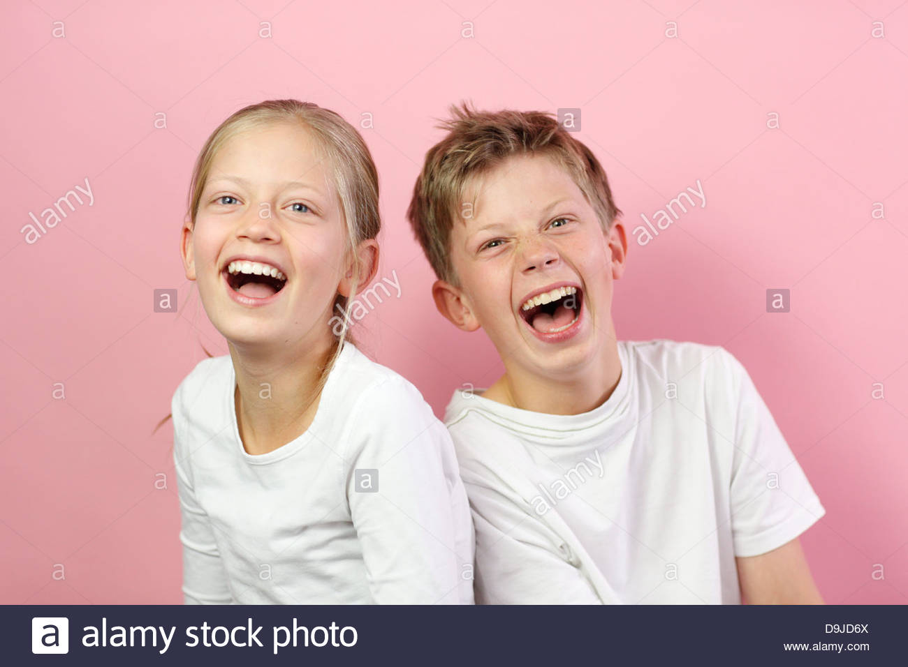 Brother and sister smiling together - Stock Image