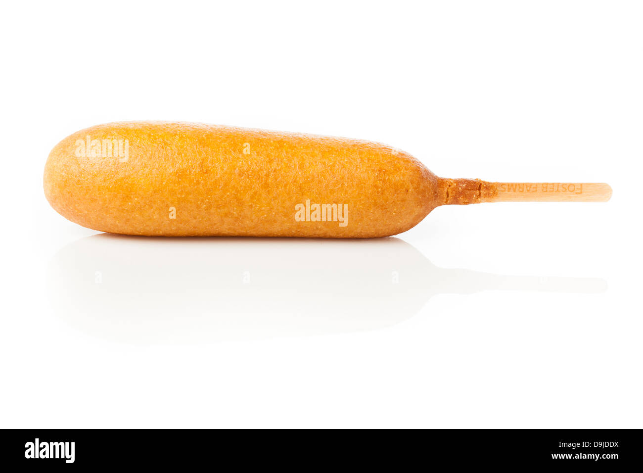 Organic CornDog on a stick with ketchup and mustard - Stock Image