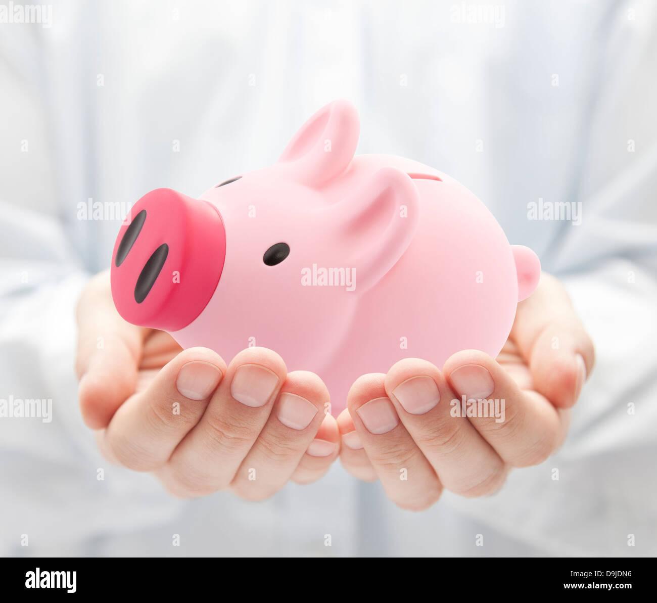 Man Holding Big Pink Piggy Bank Stock Photo 57568930 Alamy
