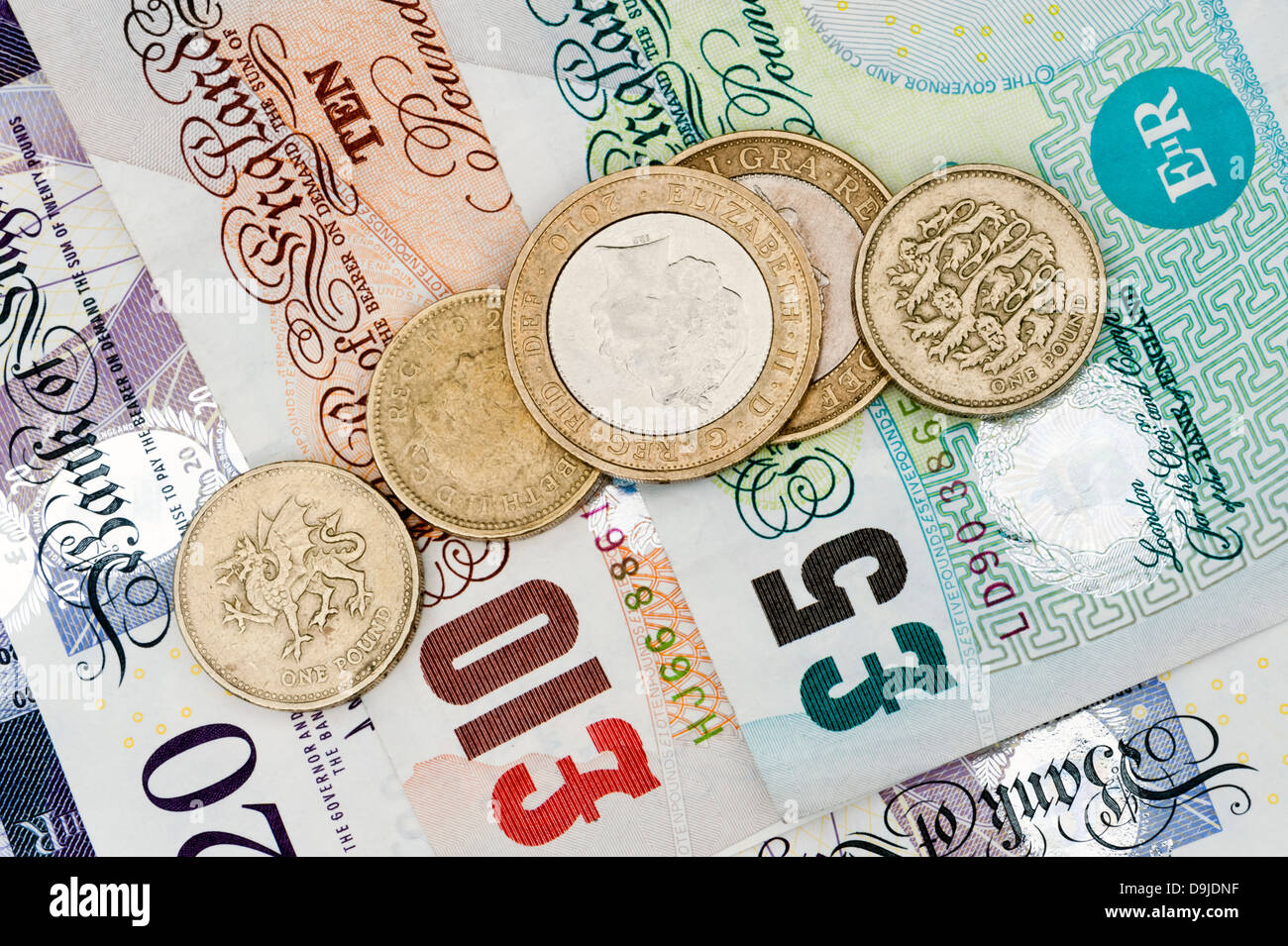 Money pounds coins cash sterling UK. - Stock Image