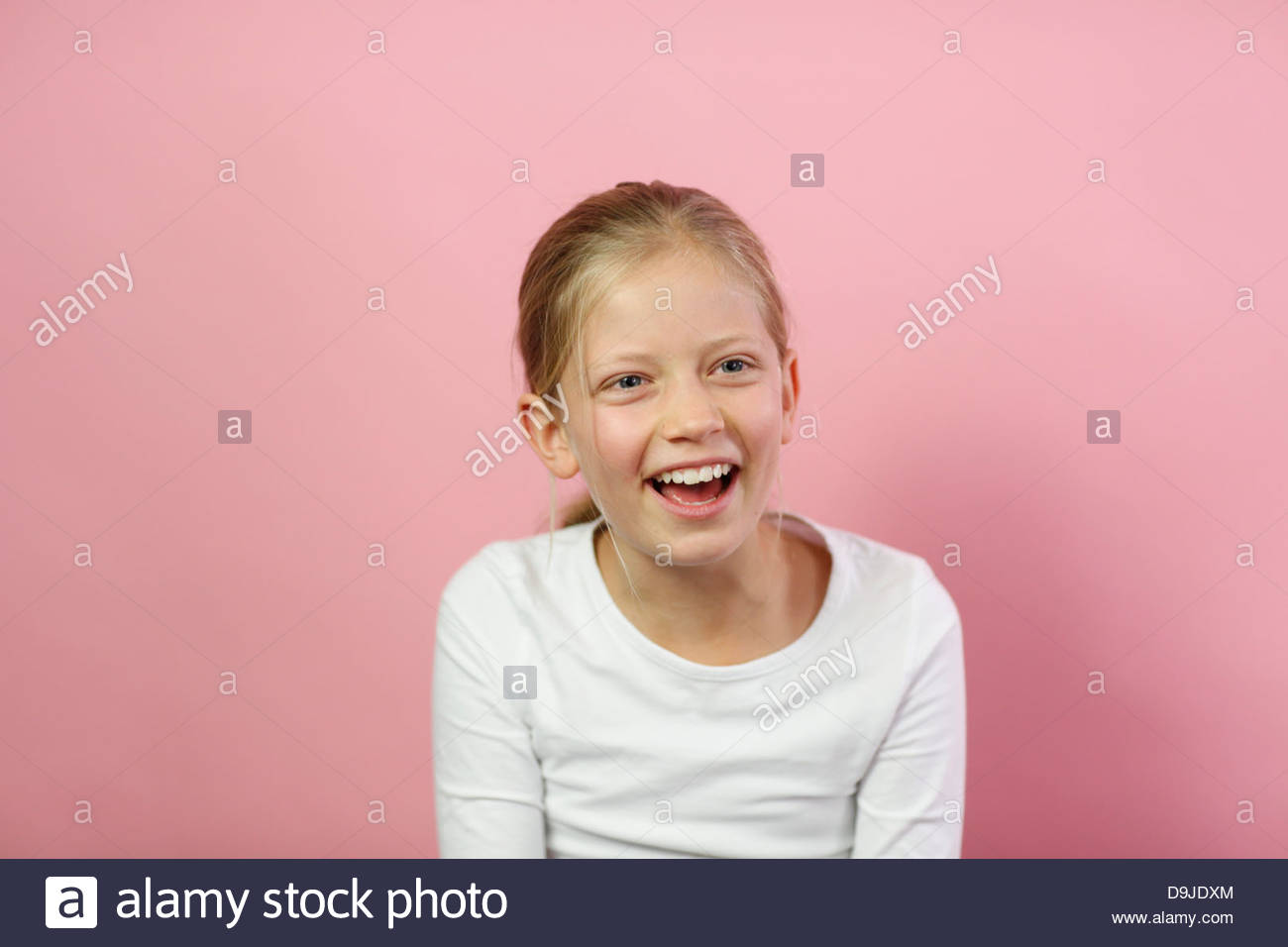 Close-up of a girl smiling - Stock Image