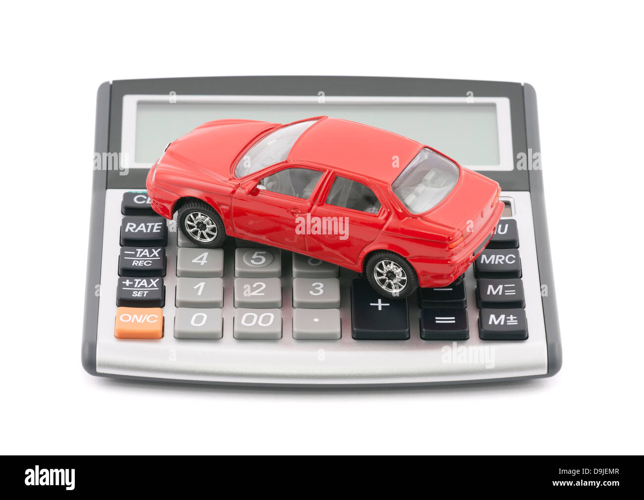 Calculator and red toy car with clipping path - Stock Image