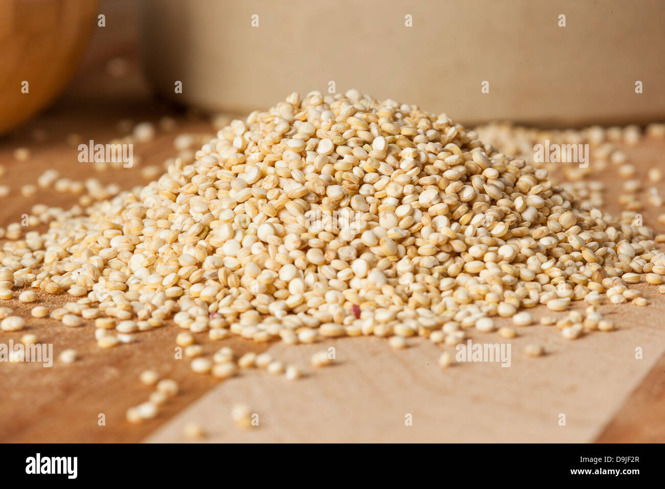 Raw Organic Quinoa Seeds against a background - Stock Image