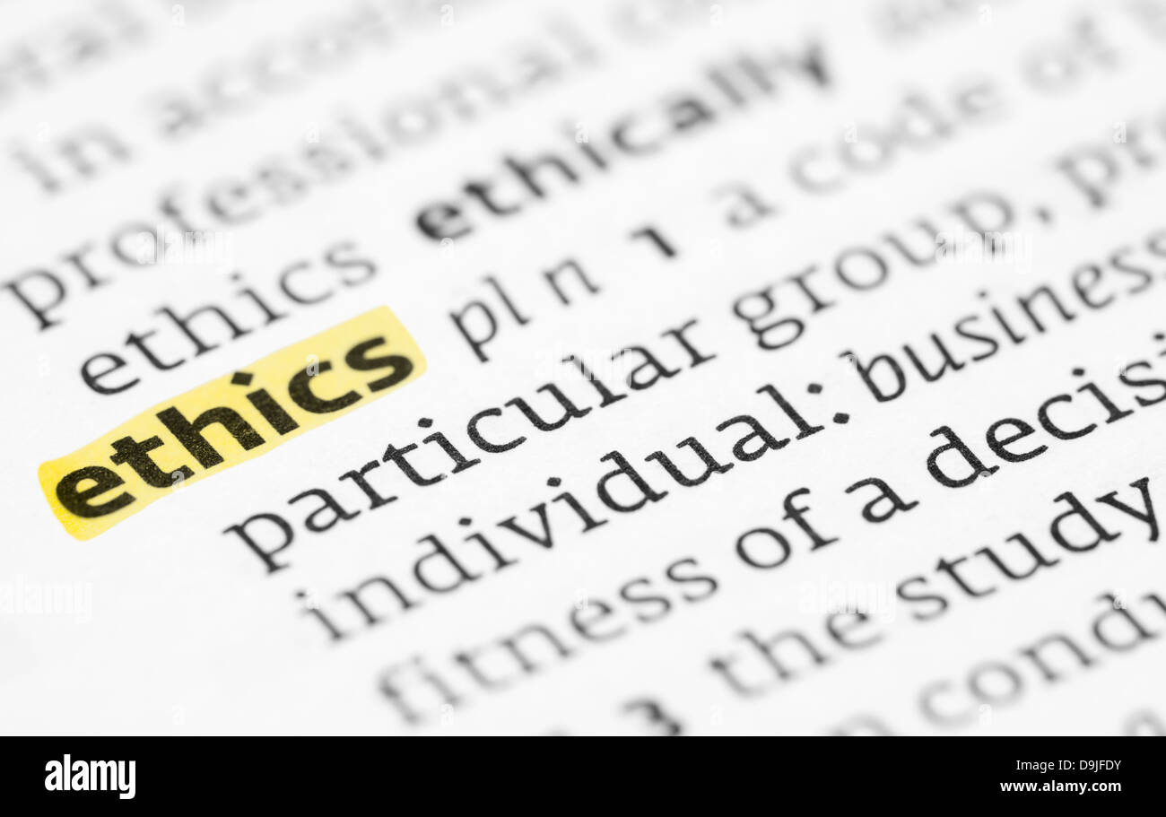 The word ethics highlighted in a dictionary - Stock Image