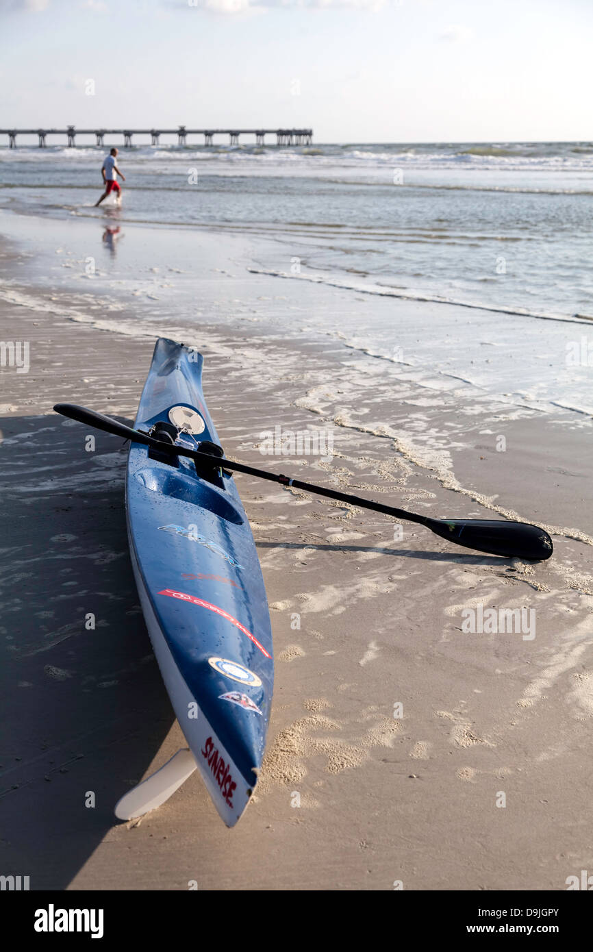 Blue ocean kayak sitting on Jacksonville Beach at the surf