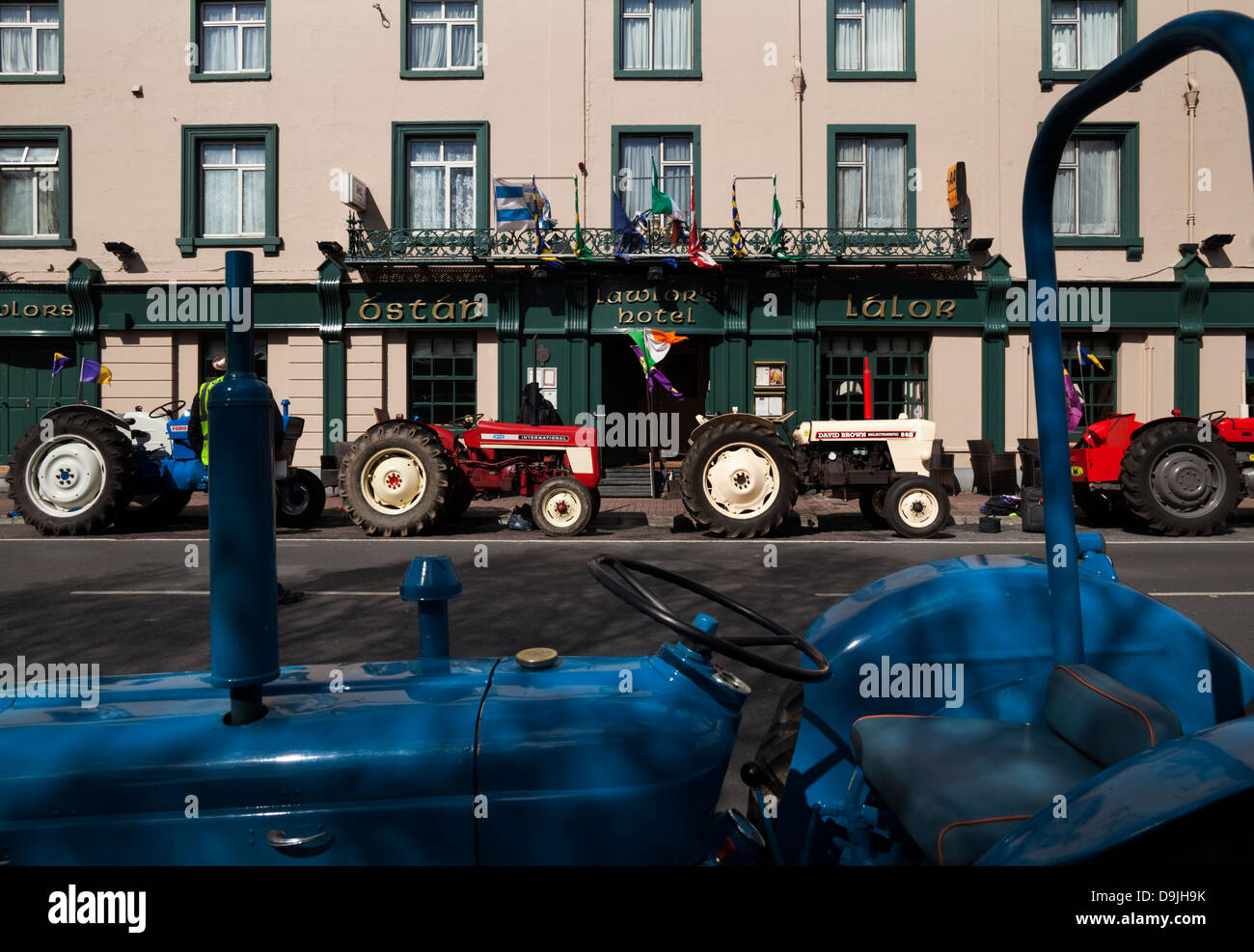 Vintage Tractors lined up outside Lalors Hotel, Dungarvan, County Waterford, Ireland - Stock Image