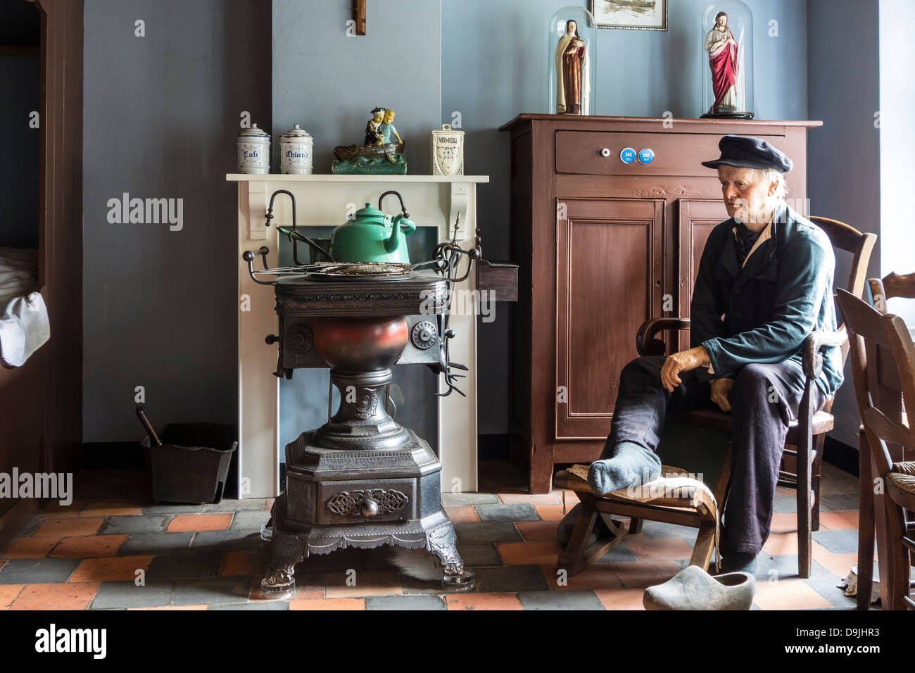 Interior with range / stove in old fisherman's house at Navigo, the National Fisheries Museum at Oostduinkerke, - Stock Image
