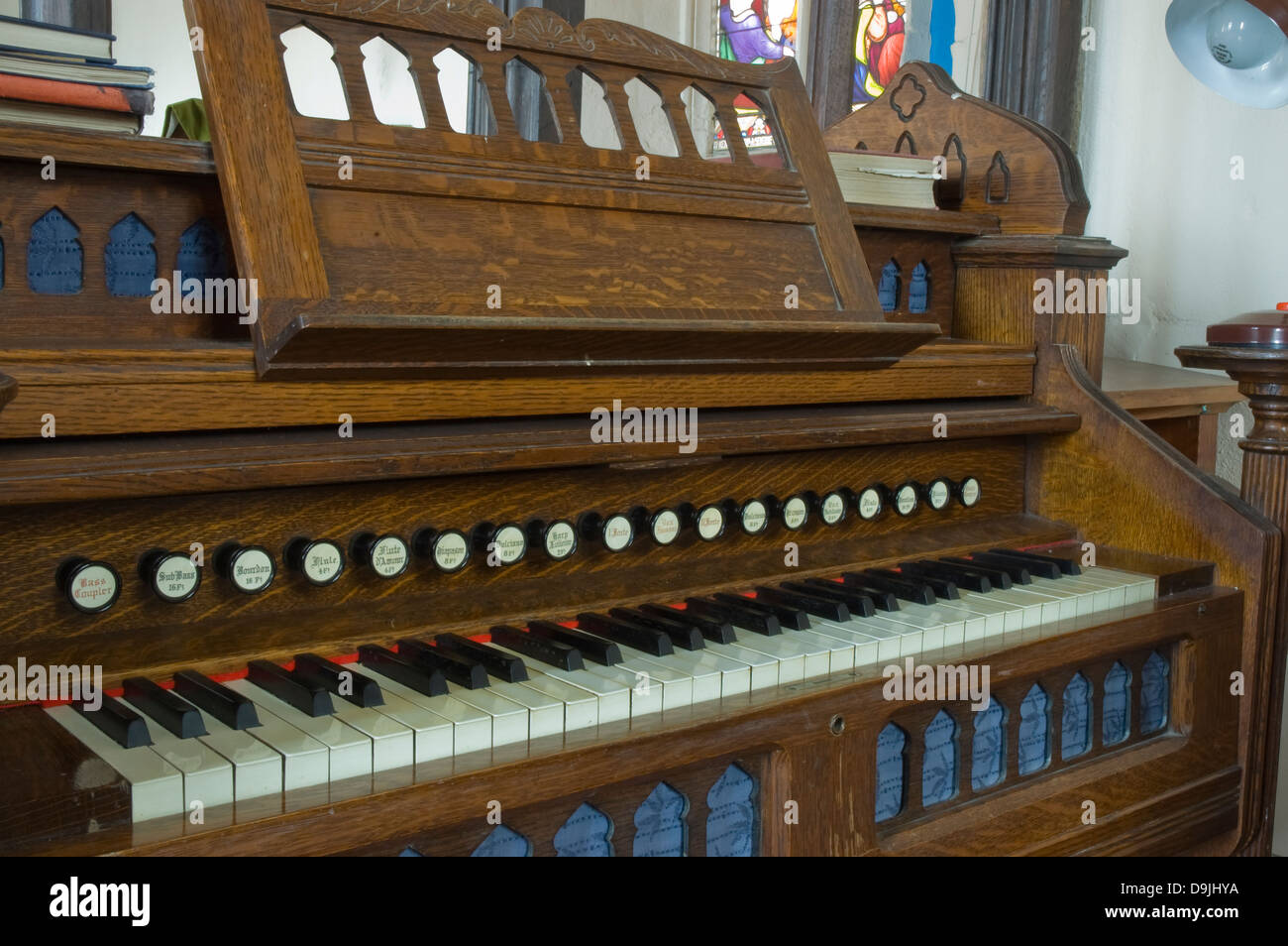 Typical harmonium or pump organ found in many churches - Stock Image