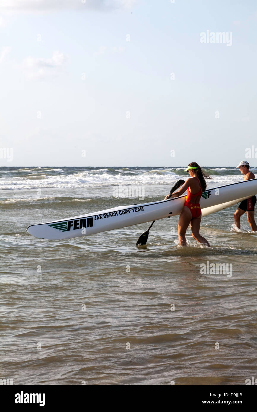 Young man and woman competing in the 4th Annual JAX Beach Paddling Challenge. Stock Photo