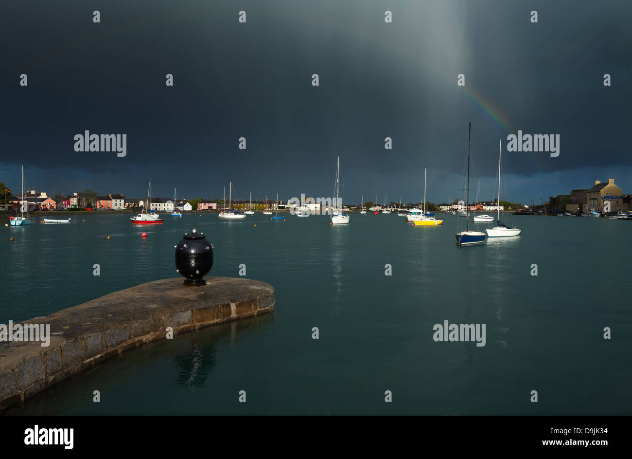 Old World War Two Sea Mine and Rainbow, The Harbour, Dungarvan, County Waterford, Ireland - Stock Image