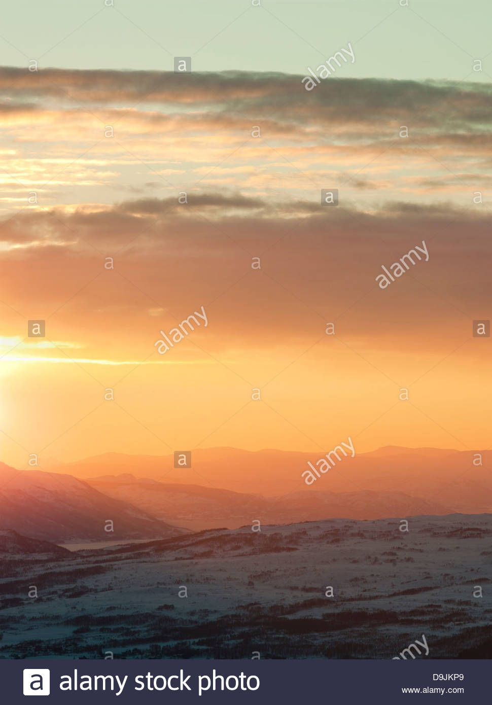 Sunset colours the landscape across the mountains, seen from Mount Storsteinen at Tromso, Norway - Stock Image