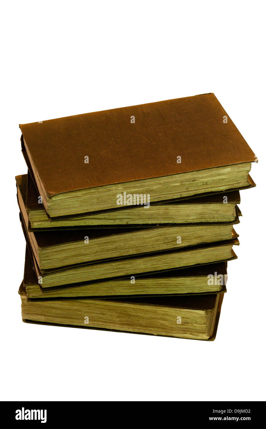 A pile of dusty old books. - Stock Image